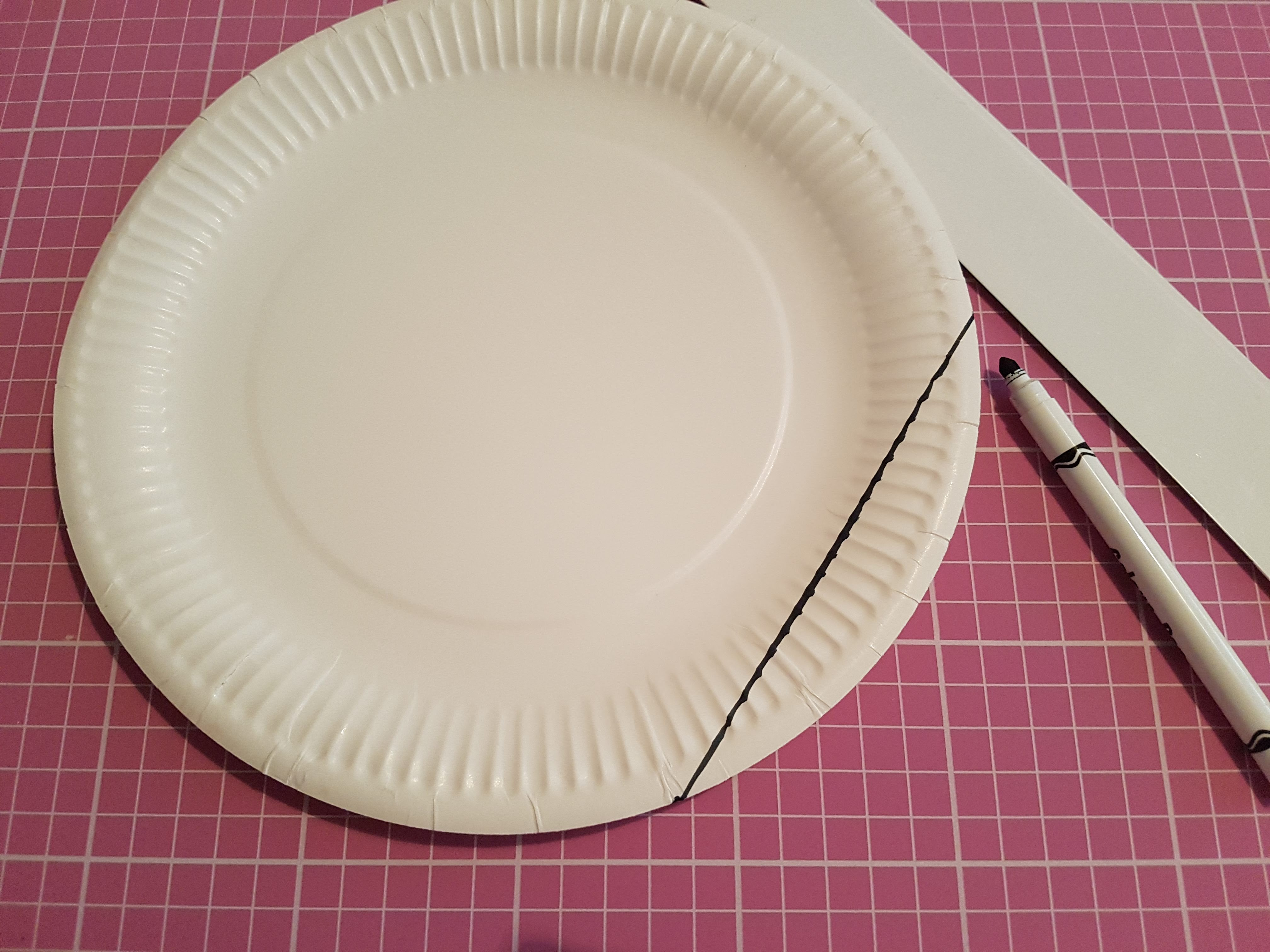paper plate with a chord drawn