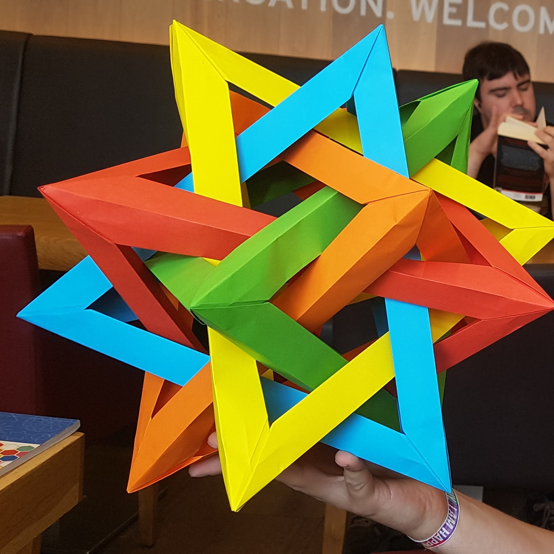 Five intersecting origami tetrahedra
