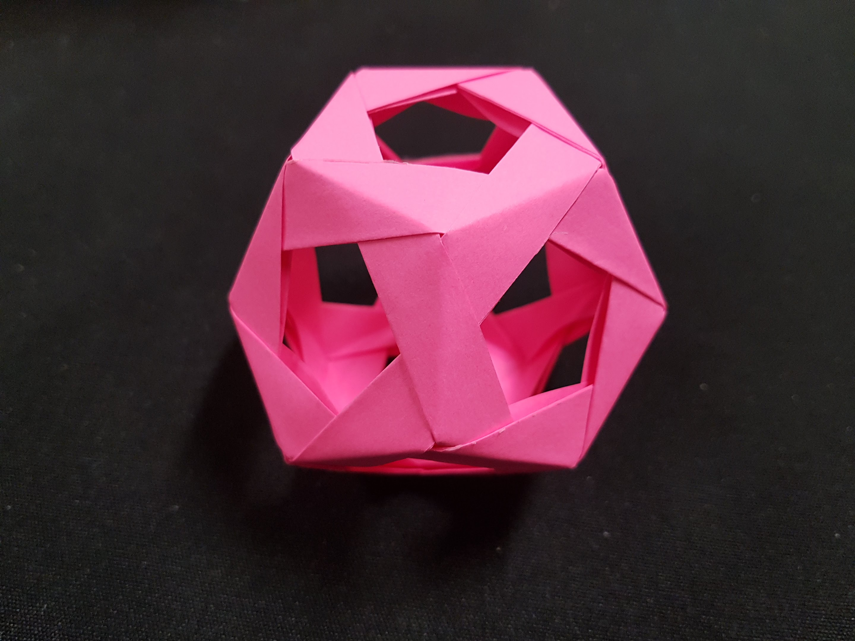 Pink dodecahedron made from post-it notes