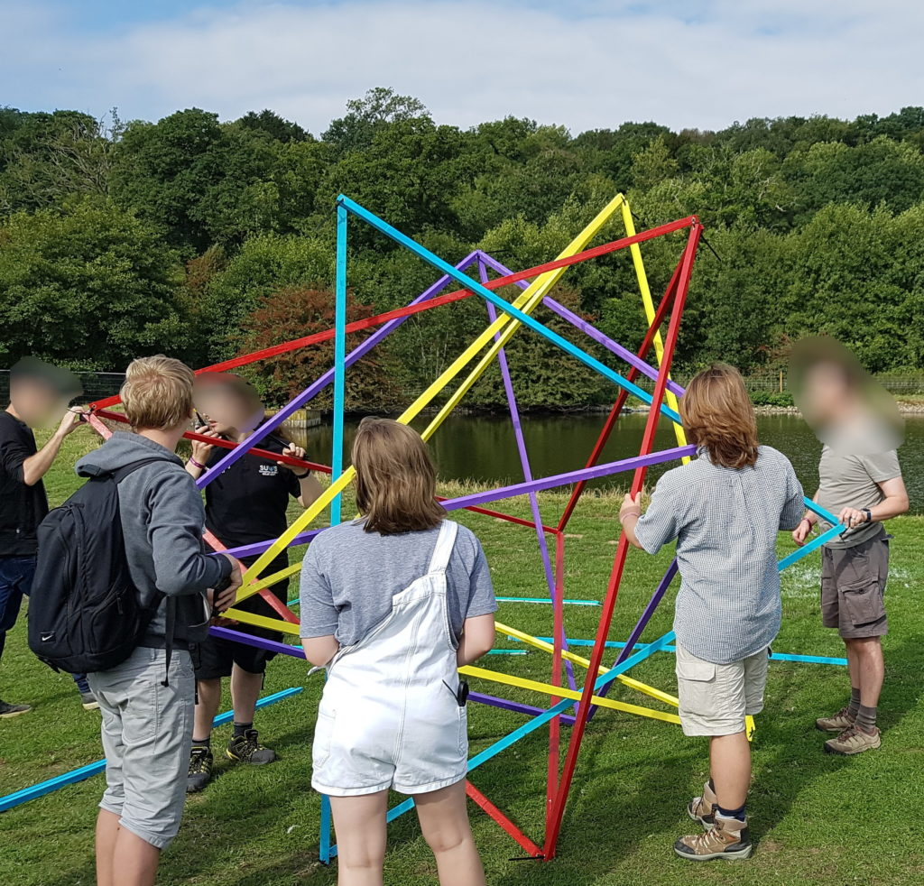 Five intersecting tetrahedra model in a field