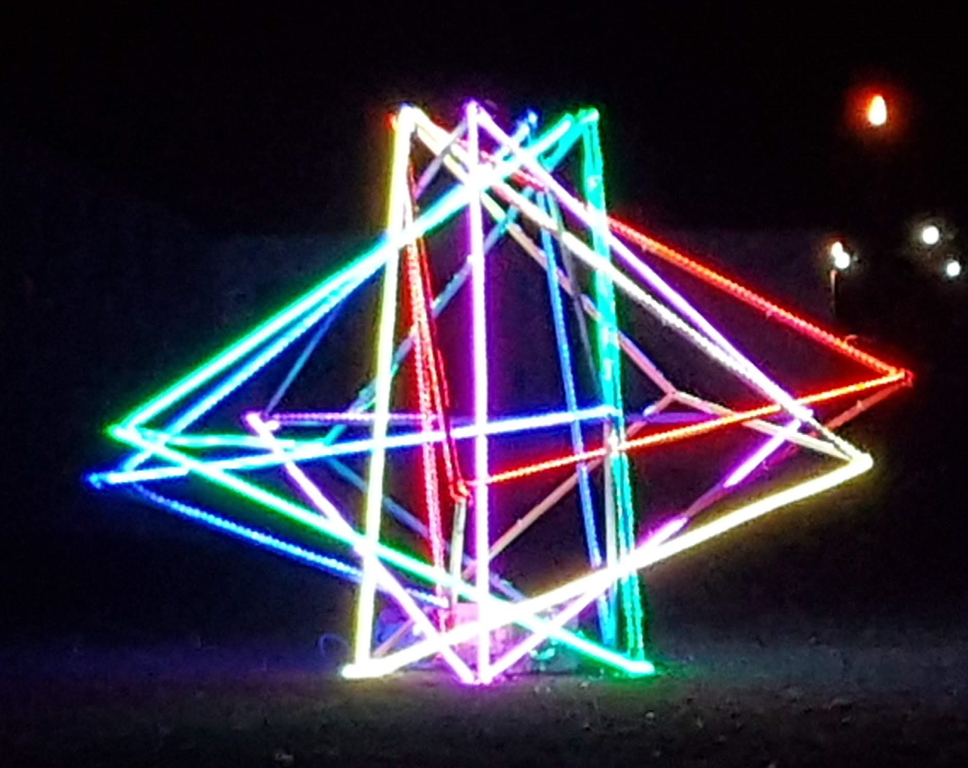 Five intersecting tetrahedra lit up at night